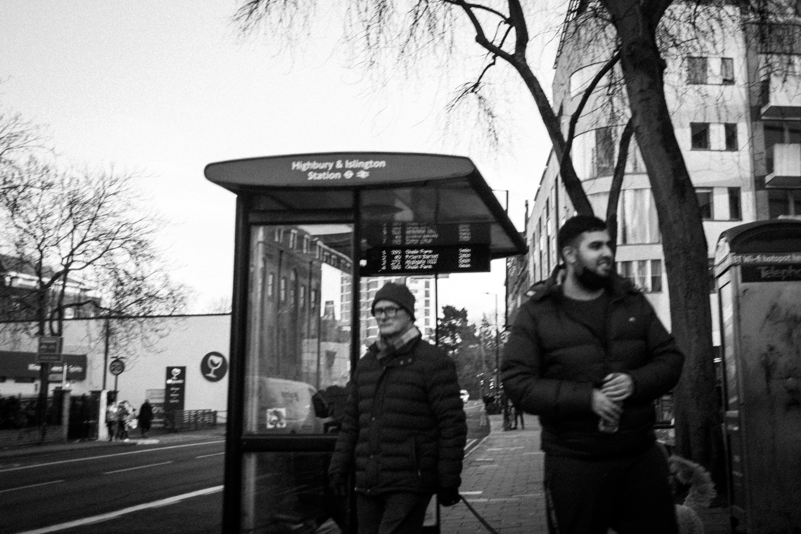 Two men at the bus stop